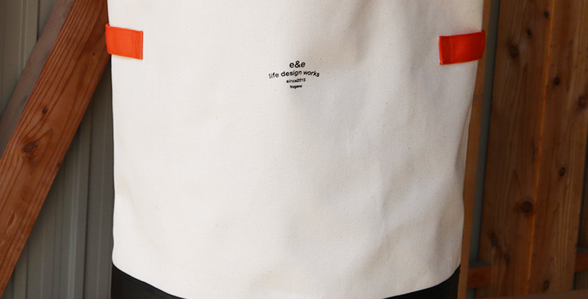 CANVAS STORAGE BAG (WHITE×BLACK / ORANGE TAPE)