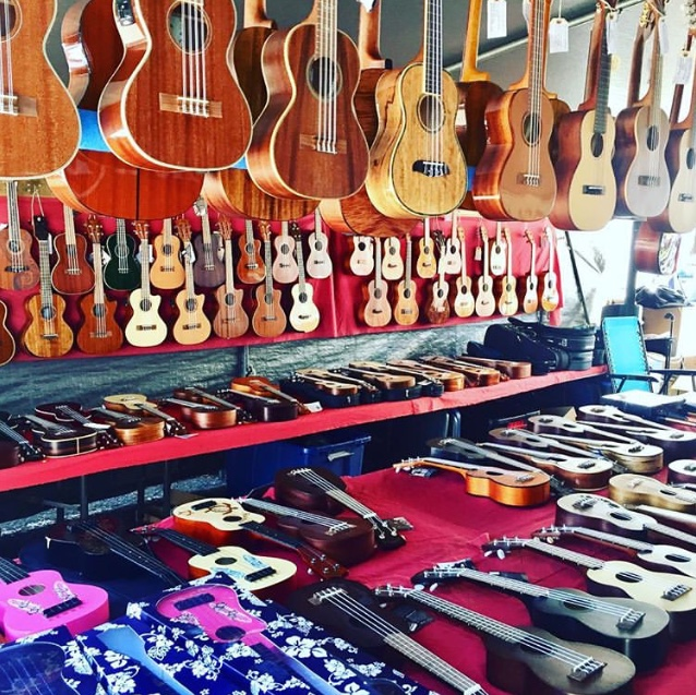 Many ukuleles of all colors and styles