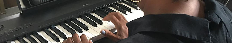 Adult student practicing piano
