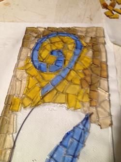 A glass mosaic piece created at Gaia