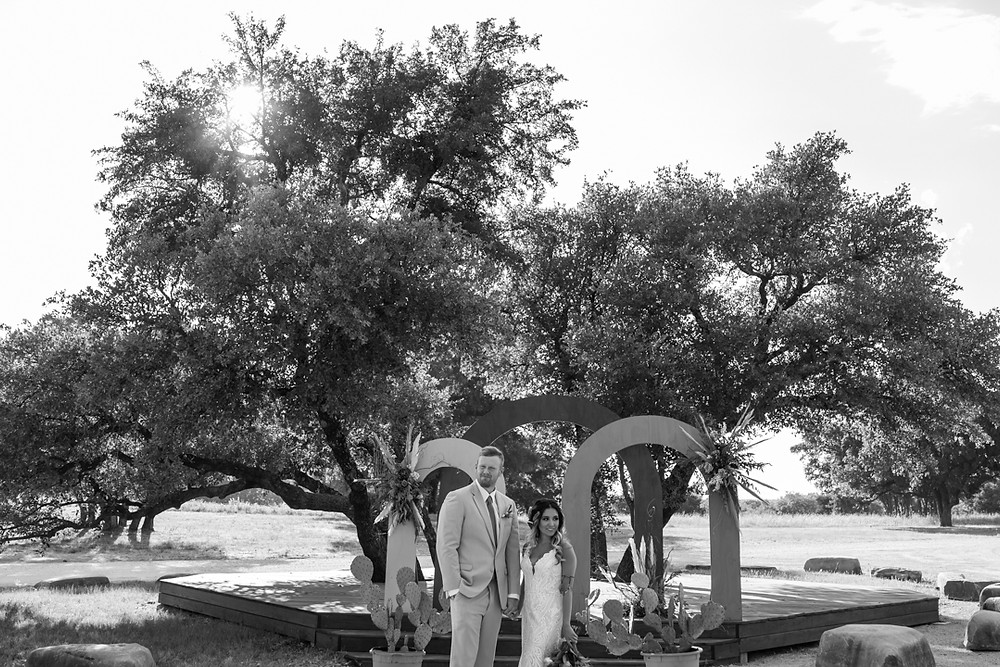 bride and groom holding hands during their texas wedding
