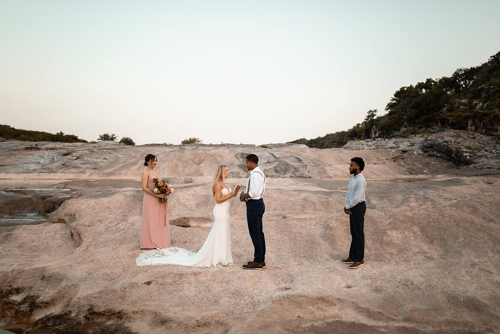 An elopement ceremony taking place at pedernales falls state park