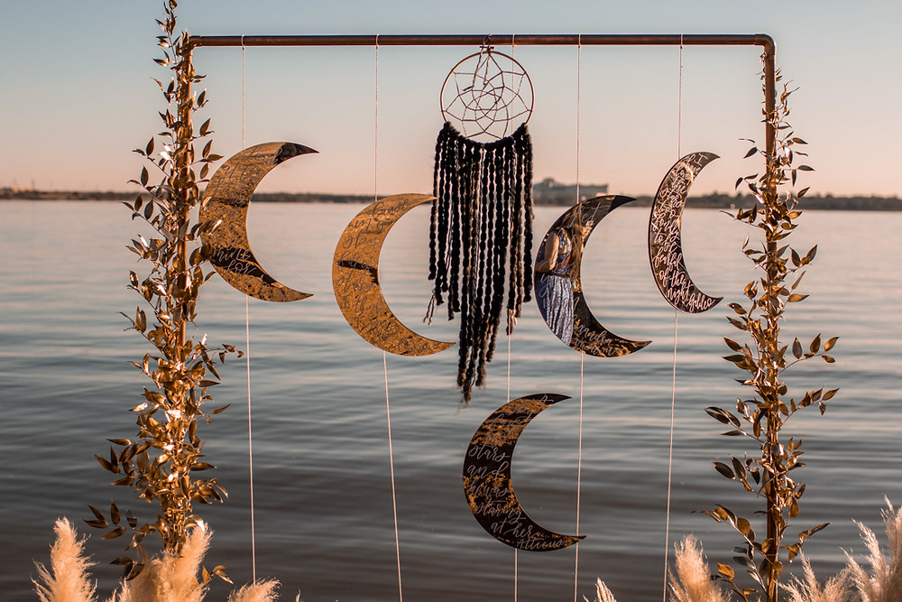 a ceremony arch for a celestial themed texas lakeside elopement