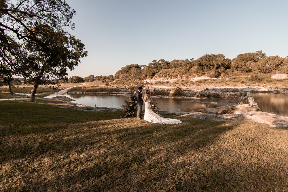 A couple saying their vows during their elopement beside a texas river
