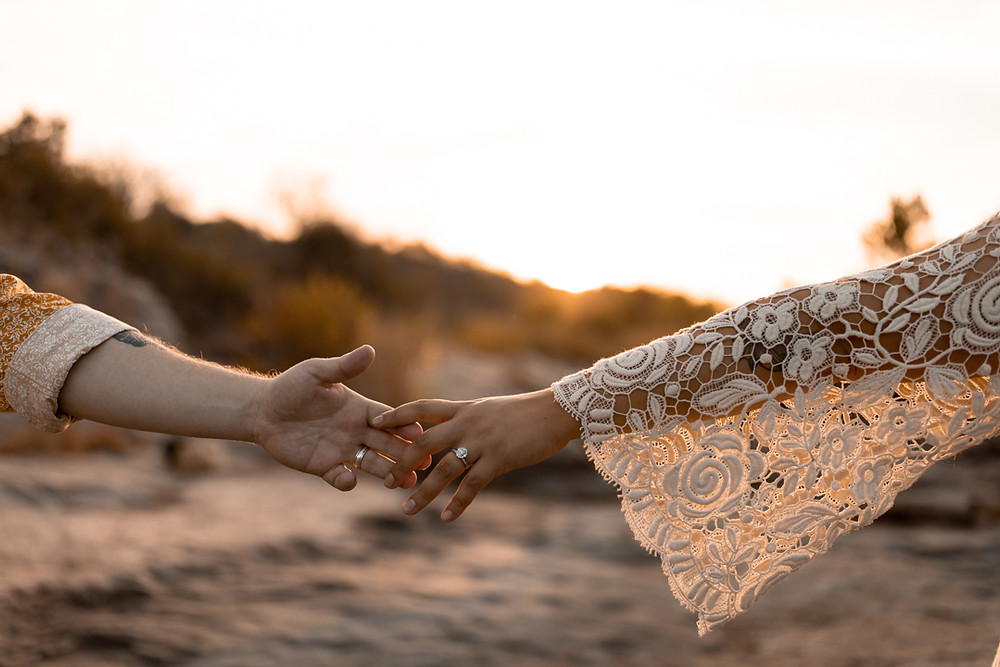 Bride and groom touching hands during their inks lake state park elopement in texas