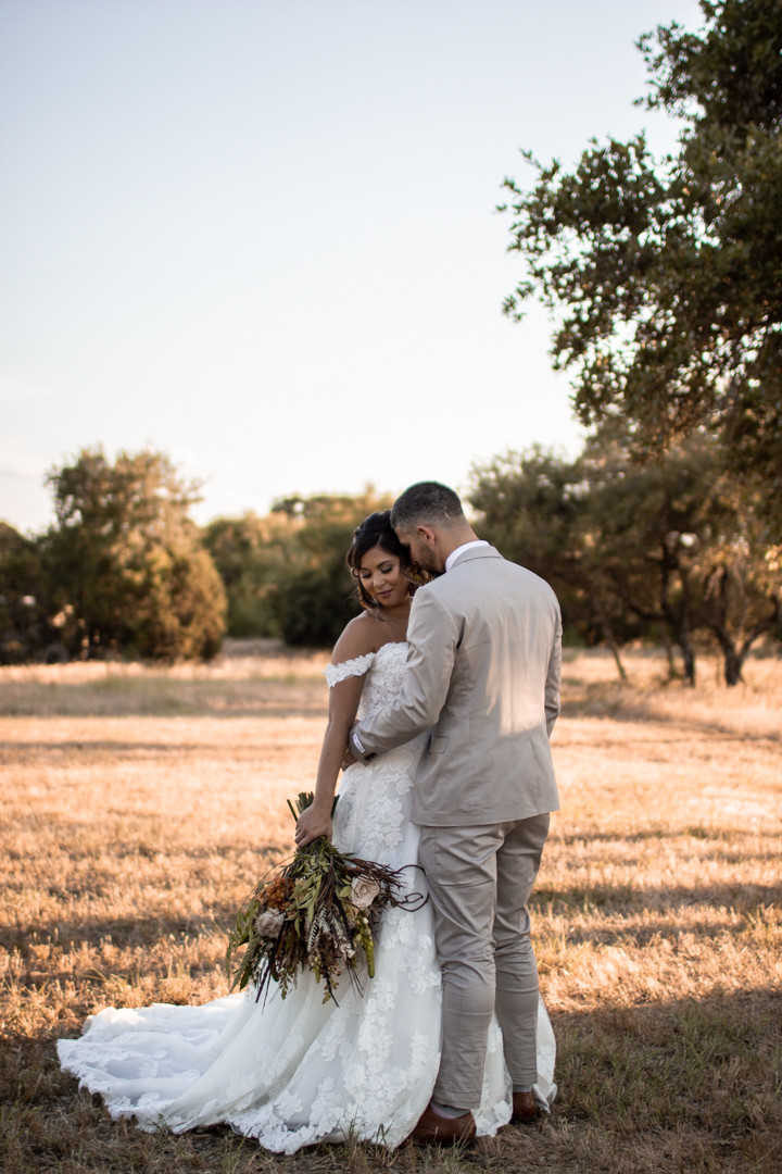 Bride and groom at graham texas wedding in a warm and earthy photo