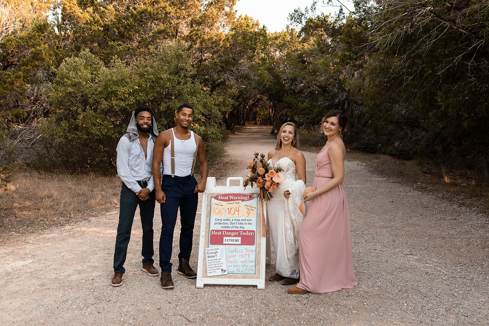 A wedding party hiking through pedernales falls state park