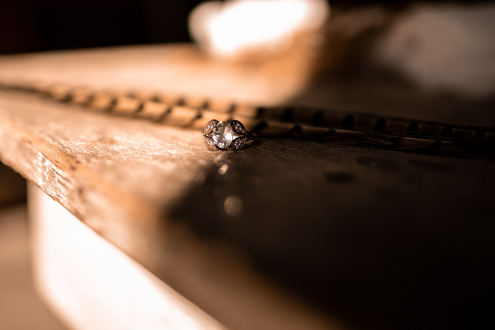 Wedding ring laying on a table with southwestern styled decor at a texas wedding