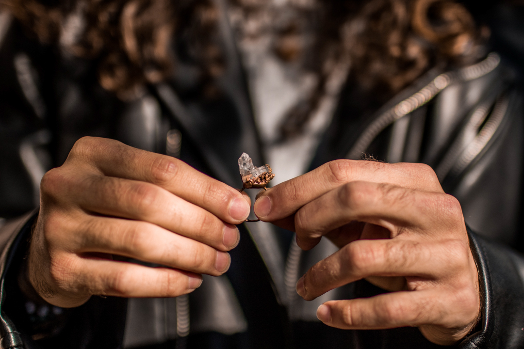groom holding his brides ring on his elopement day in texas