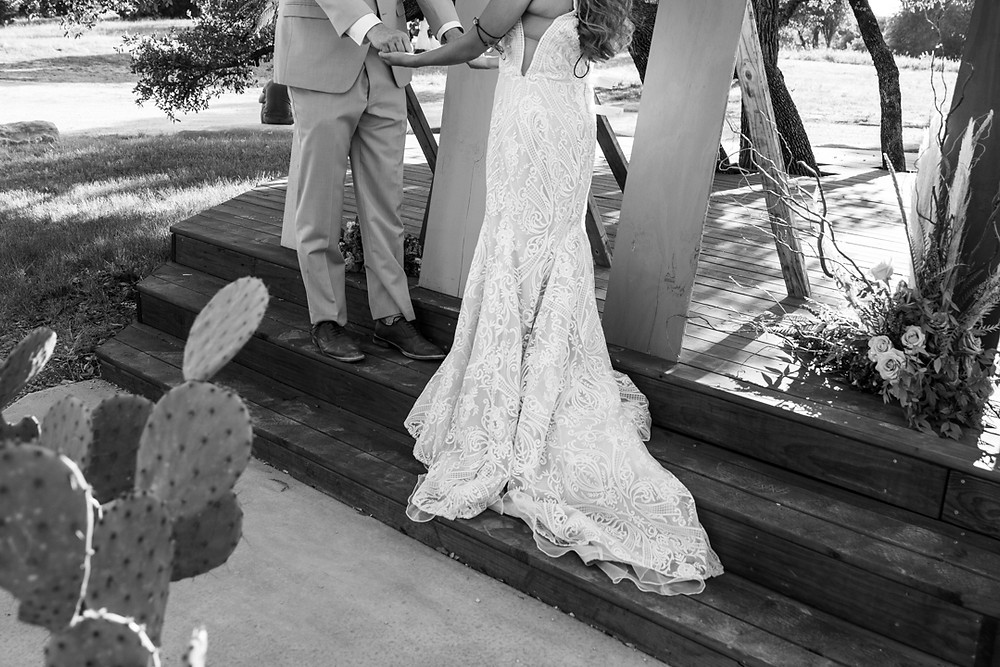 bride and groom saying their vows at their texas hill country boho styled wedding