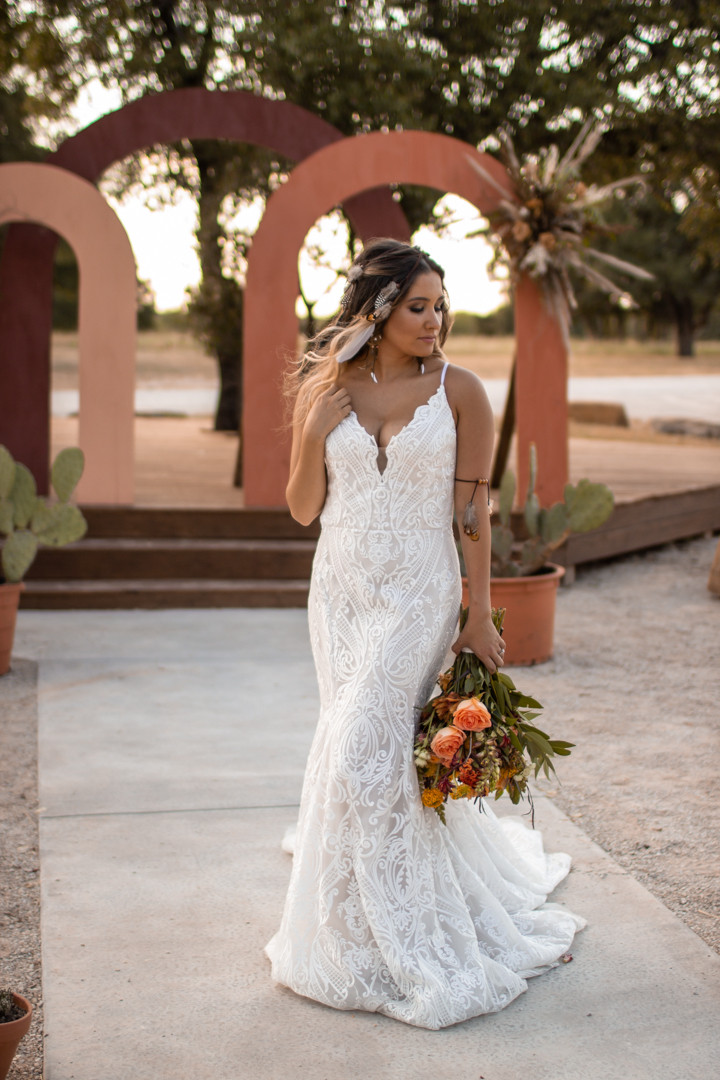 Bride in front of terra cotta arches