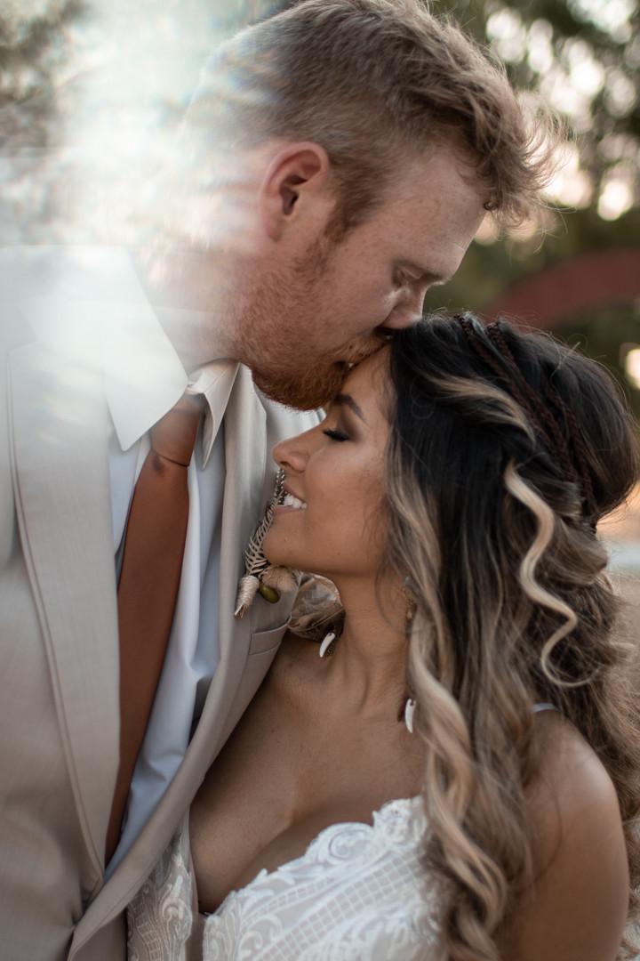 Groom kissing brides forehead in graham texas wedding