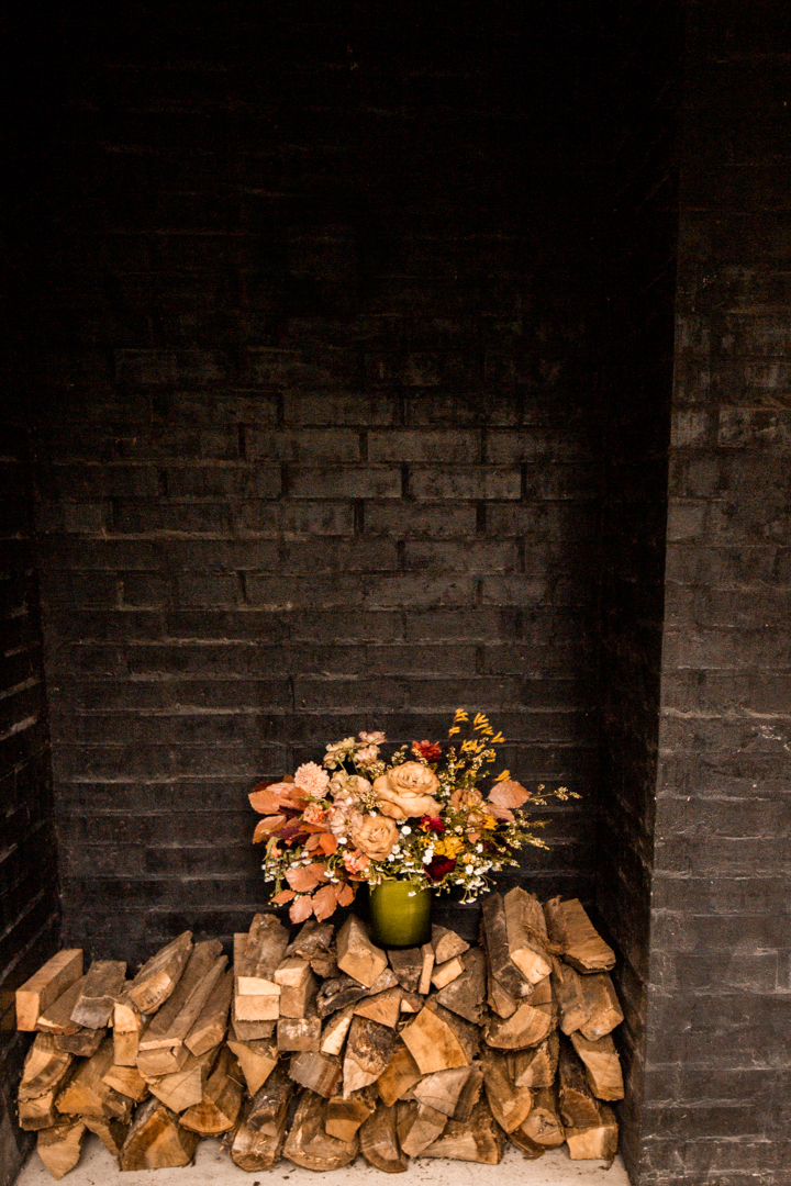 Bridal bouquet against a black brick wall for a moody fall wedding in Texas