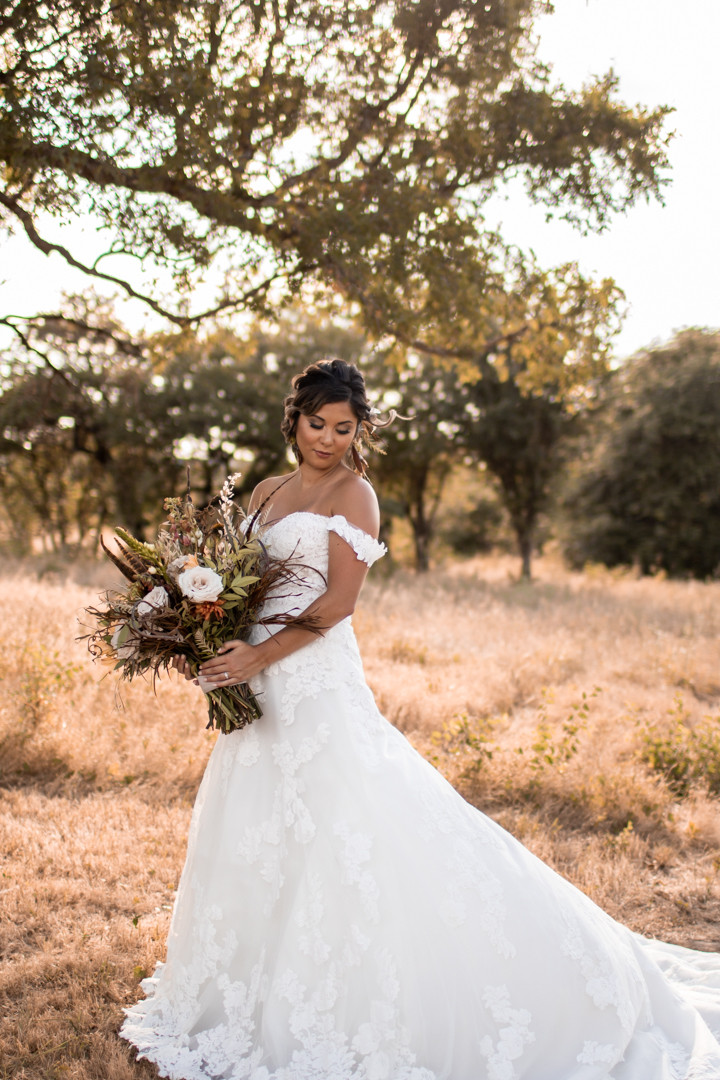 Bride in her wedding dress holding her boho style bouquet in graham texas