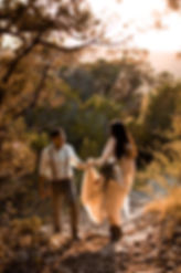 Bride and Groom hiking in the texas hill country to get married
