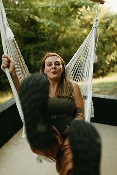 Adventure Wedding photographer swinging in hammock in east texas