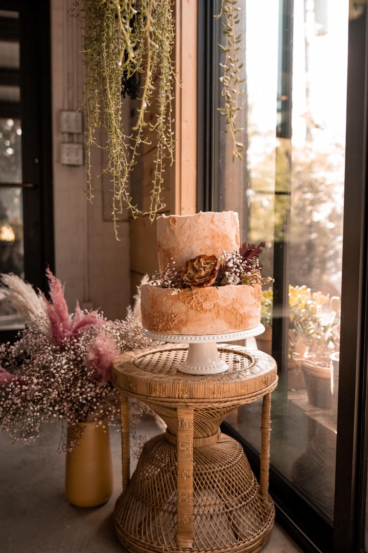 Peach boho styled wedding cake for a moody fall wedding in Texas