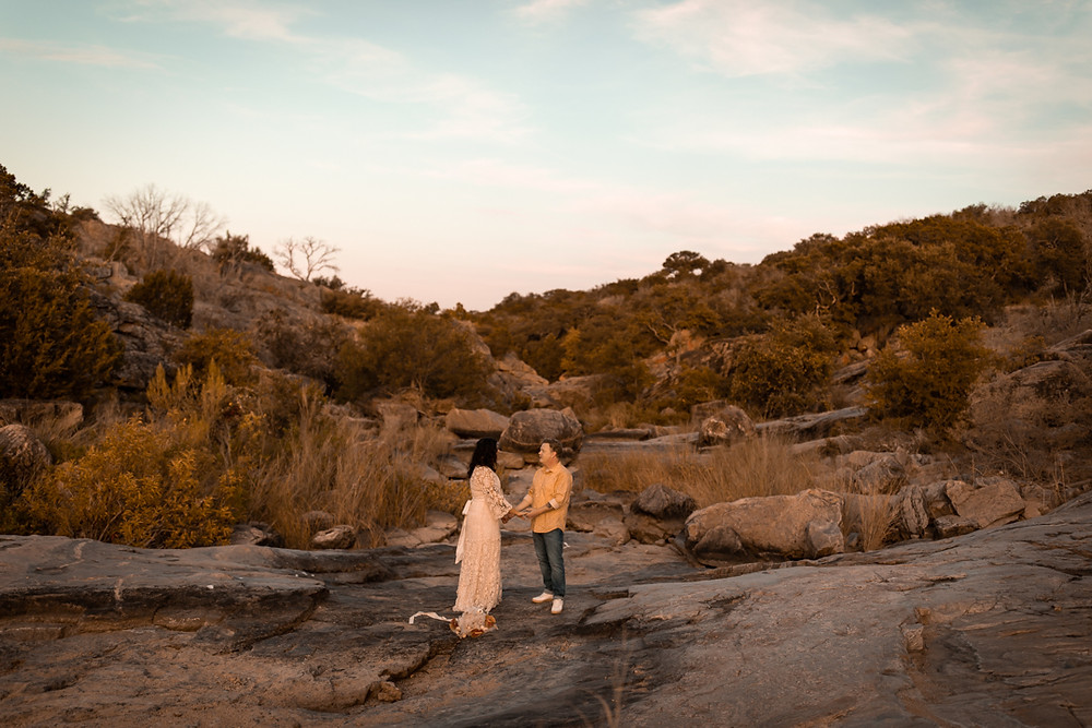 Couple saying their vows during their adventure wedding in the texas hill country