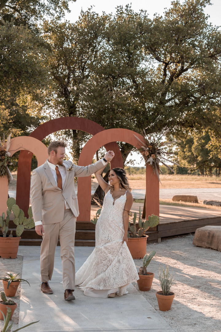 bride and groom excited to be married at sparrow creek ranch in Texas hillcountry