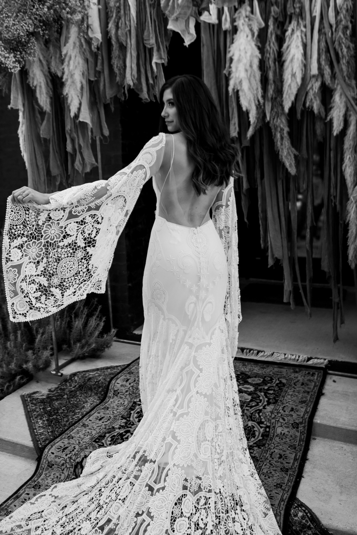 Bride showing off her boho wedding dress details during her fall wedding in Texas