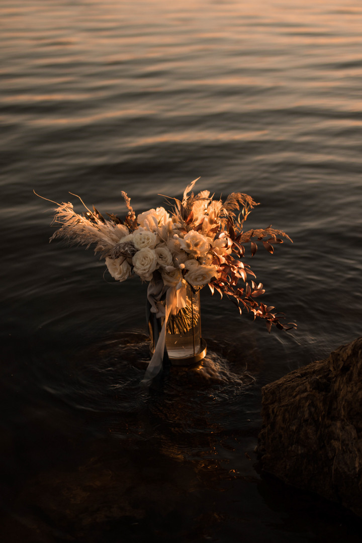 a bouquet for a texas lakeside adventure elopement
