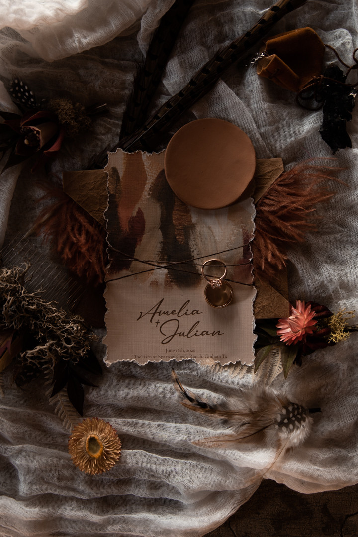 A bohemian and moody invitation suite