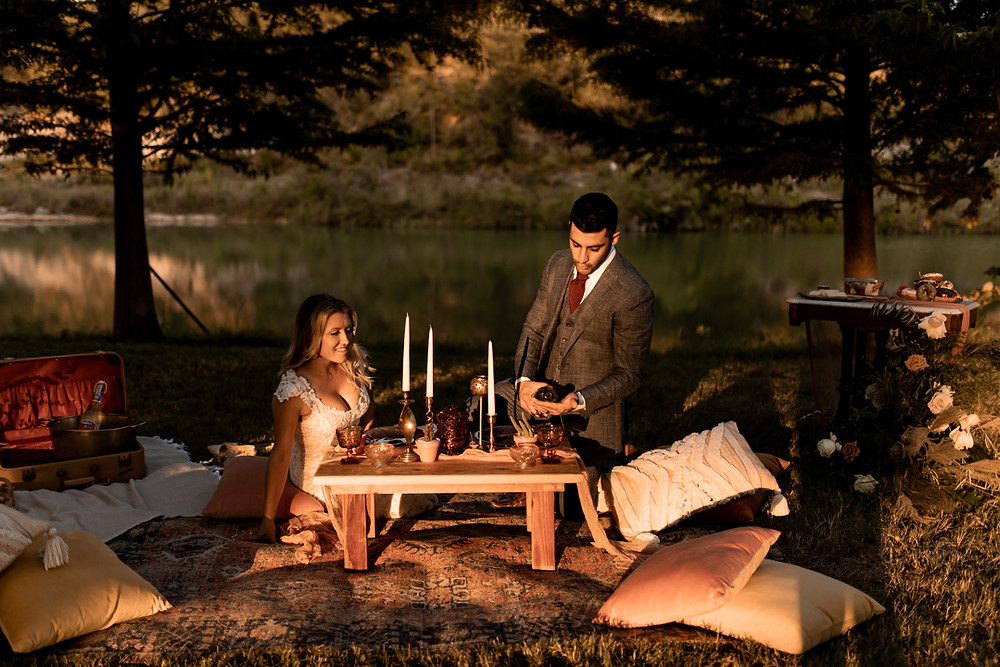 A couple enjoying their romantic elopement picnic in the texas hill country
