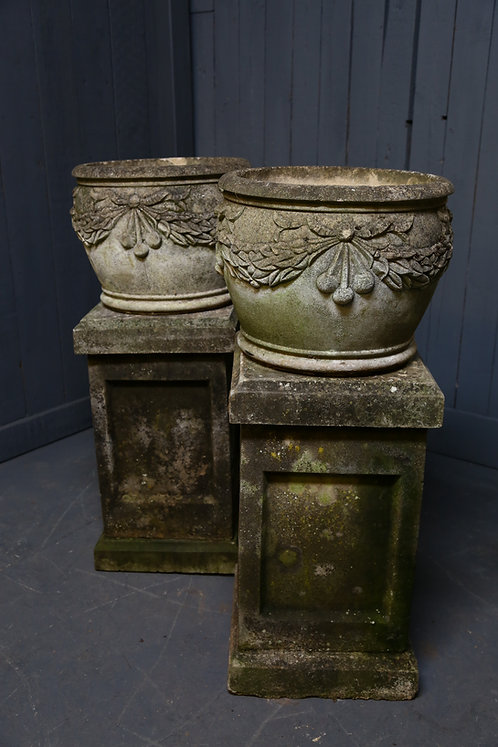 C20th Pair of composition urns with floral swags