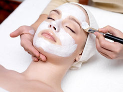 Beautiful woman with facial mask at beau