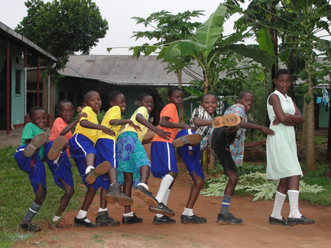 Kids in conga line all kicking