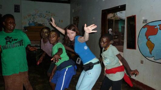 Kids dancing with volunteer