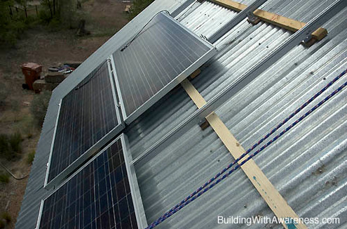 Solar panels used to charge batteries for lights at Kin