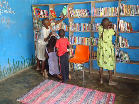Kids stocking the library shelves
