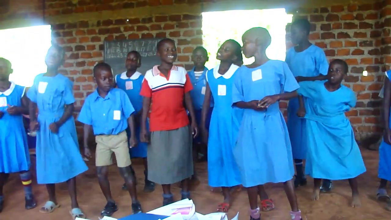 Kin kids singing welcome song and dancing