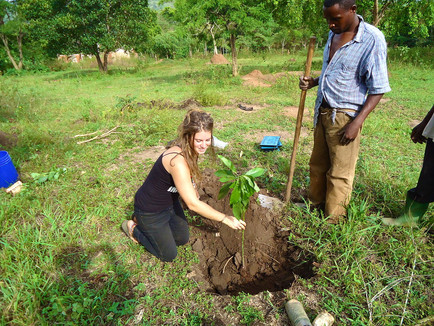 Volunteer helping with farm