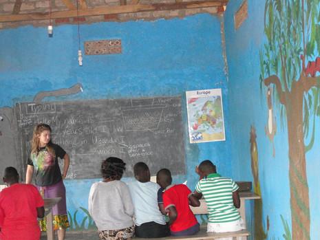 Volunteer teaching in the school room at kin
