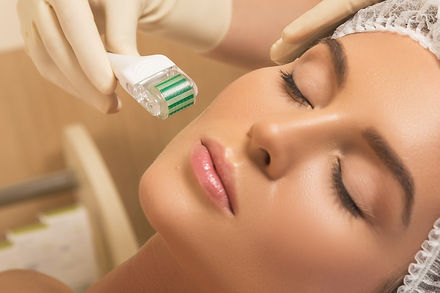 Beautiful woman in beauty salon during mesotherapy procedure.jpg  Face microneedling treatment with