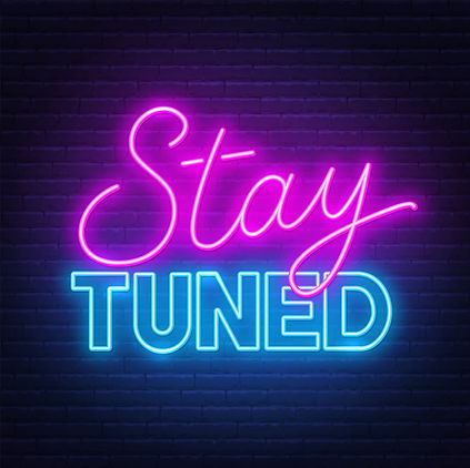 neon-sign-stay-tuned-on-brick-wall-backg