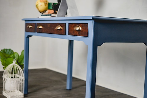 Duotone cherry and periwinkle desk with golden accents