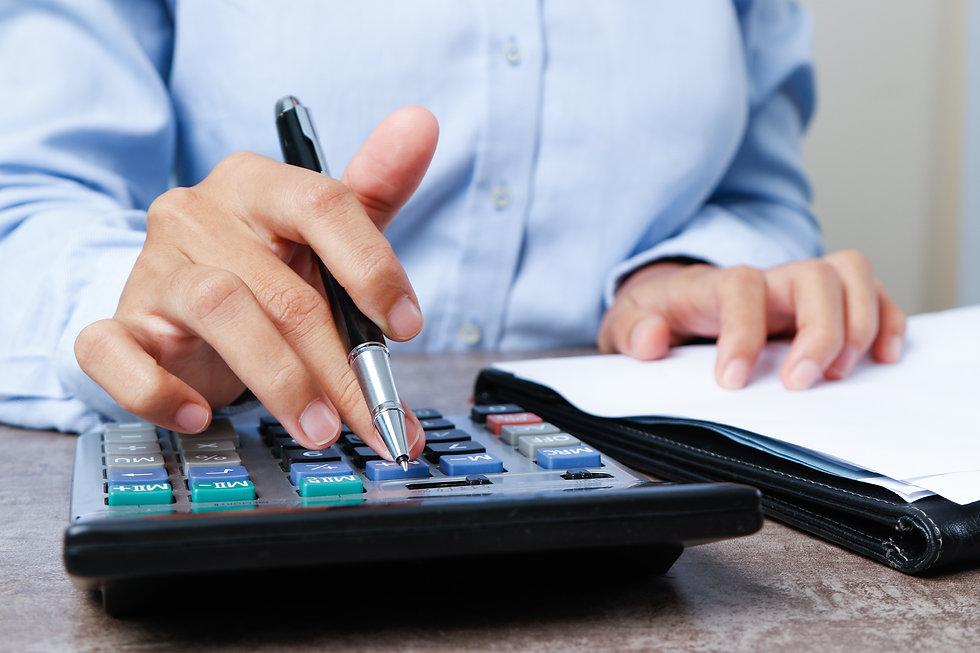 closeup-marketing-expert-using-calculato