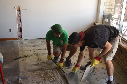Brothers removing tile