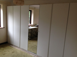 A whole wall of Ikea PAX hinged wardrobes assembled by www.norwichflatpack.co.uk