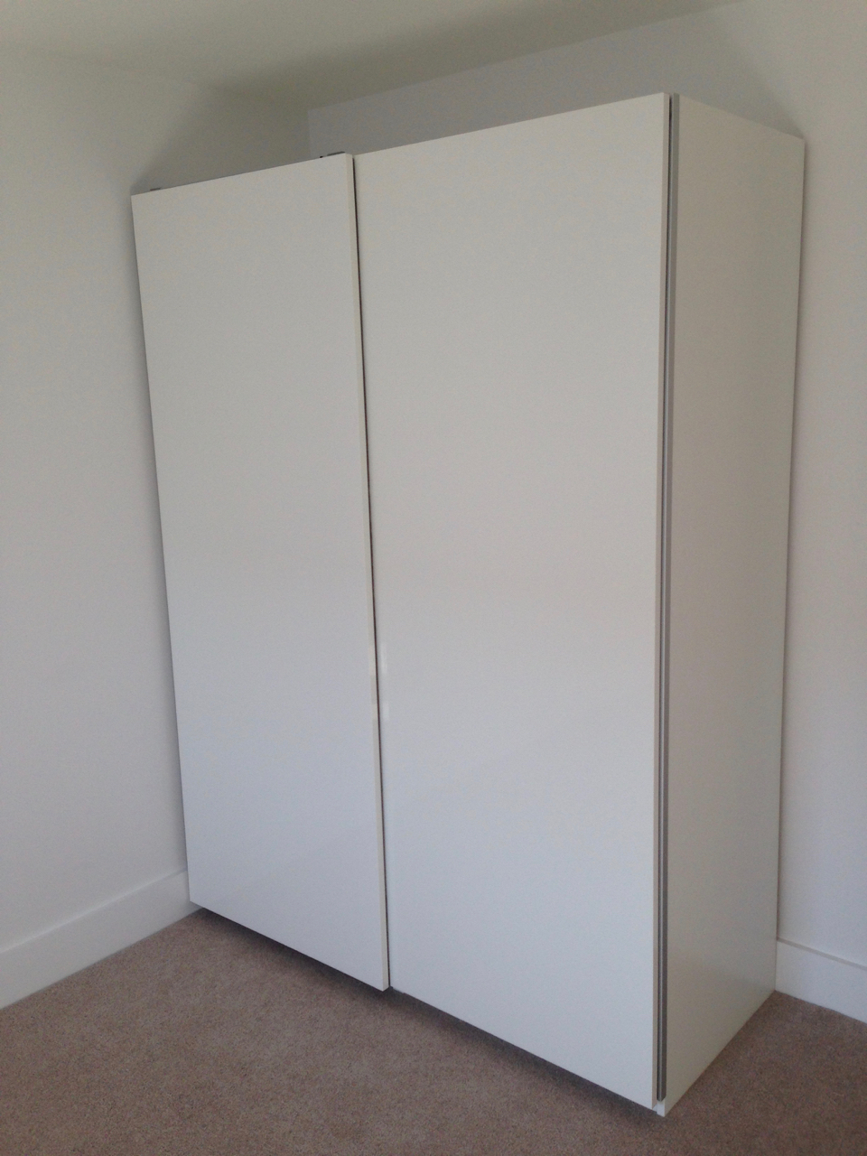 Ikea PAX sliding wardrobes Hasvik white doors assembled by www.norwichflatpack.co.uk