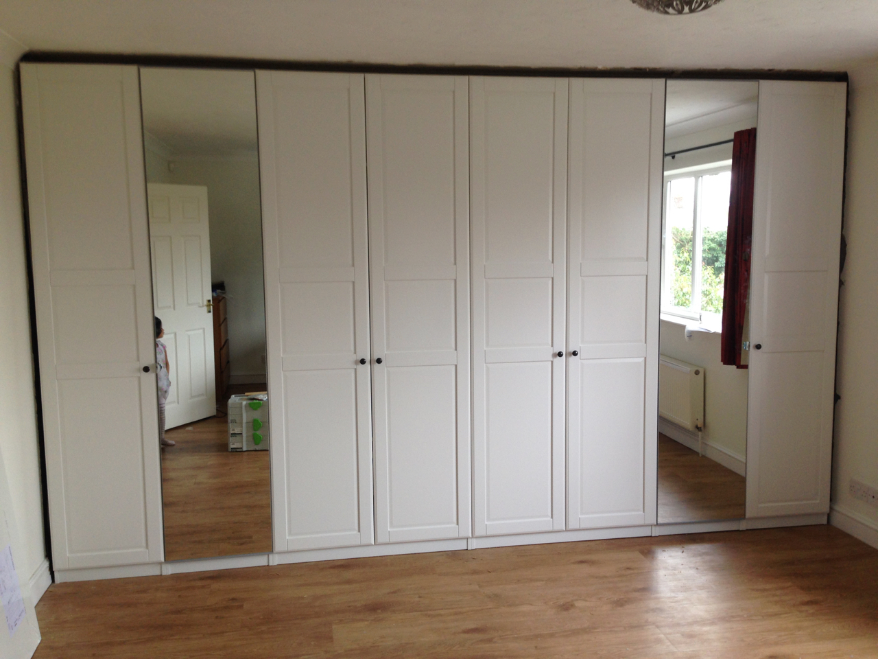 4m run of Ikea PAX hinged wardrobes assembled by www.norwichflatpack.co.uk
