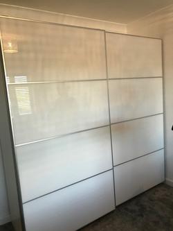Ikea PAX 2m wide sliding wardrobe assembled by www.norwichflatpack.co.uk