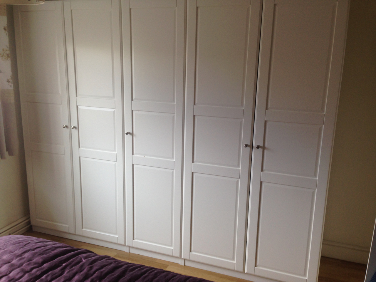 2.5m wide run of Ikea PAX hinged wardrobes assembled by www.norwichflatpack.co.uk