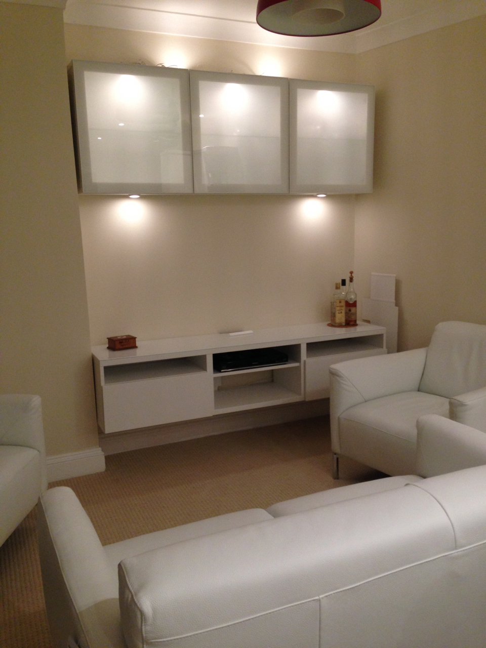 Ikea besta TV unit and cupboards with internal and external lighting