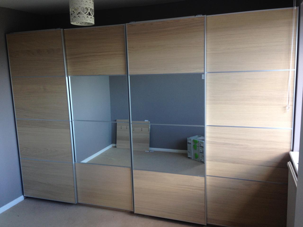 Ikea PAX sliding oak and mirrored wardrobes assembled by www.norwichflatpack.co.uk