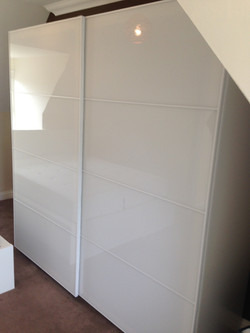 Ikea PAX sliding wardrobes space saving assembled by www.norwichflatpack.co.uk