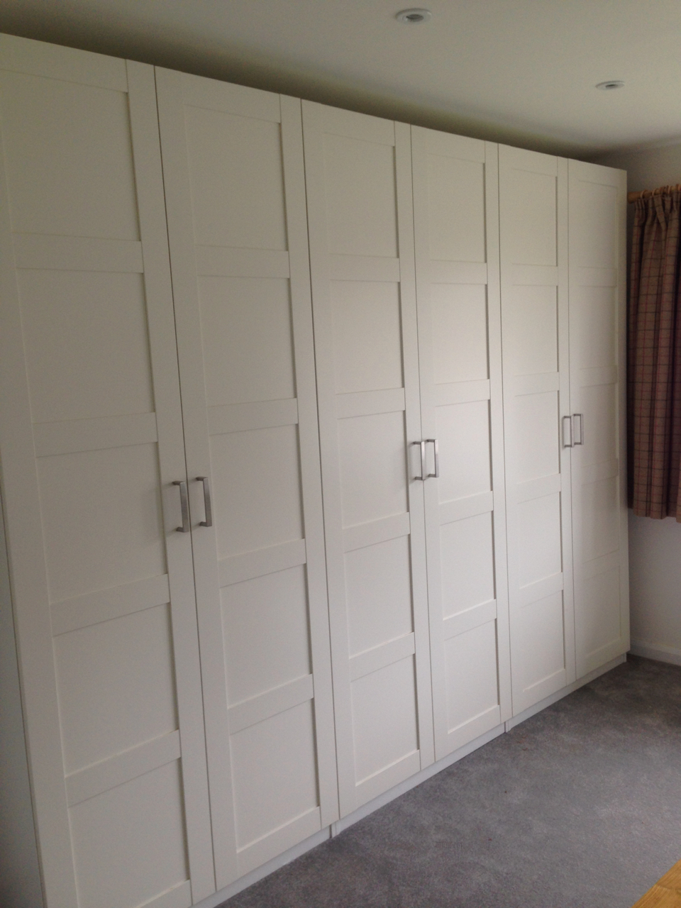 3m run of Ikea PAX hinged wardrobes assembled by www.norwichflatpack.co.uk